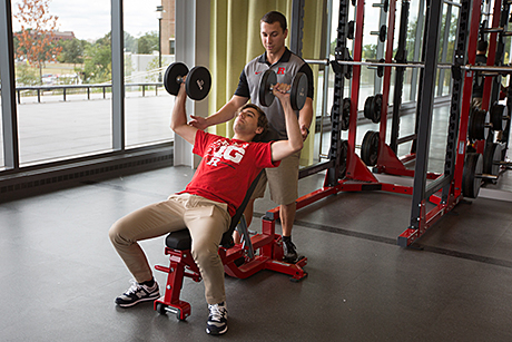 Photo: Student working out with IFNH spotter.